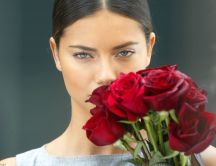Adriana Lima with red roses