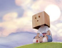 Child with a box on his head