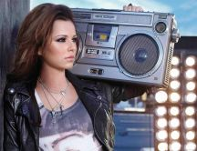 Cheryl Cole with a big cassette - hot pop star