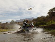 With the motorcycle through the water