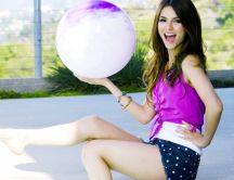 Victoria Justice holding a big white balloon