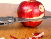 Funny art on a red apple