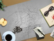 Stuff for a trip - coffee, money, sunglasses, notebook, map