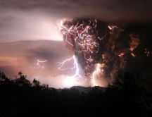 Volcano erupts - lightning on the red sky
