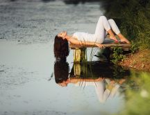 Beautiful girl lying on the lake HD wallpaper