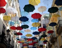 Flying colored umbrellas