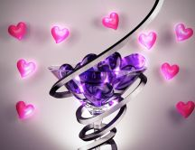 Purple hearts in a glass and pink hearts on the wall