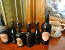 Six old bottles of beer