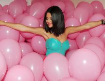 Selena Gomez - among a lot of pink balloons