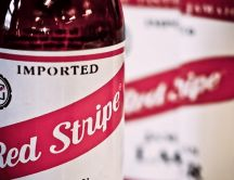 A bottle of beer close up - Red Stripe