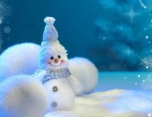 Small snowman and three big snowballs HD wallpaper