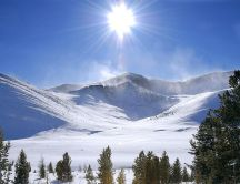 Sunlight warms the snowy mountains of Russia