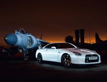 Beautiful white Nissan GT-R35 and military aircraft