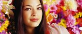 Kristin Kreuk - beautiful actress - surrounded by flowers