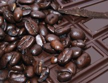 Coffee beans and pieces of chocolate
