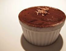 Chocolate in a cup dusted with cocoa