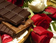 Symbols of love - chocolate and roses