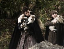 Robb Stark and Bran Stark with two young wolf