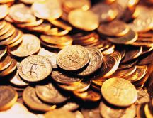Lots of golden coins - money