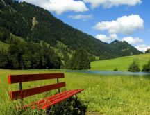 Red bench on a green field - nature HD wallpaper