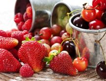 Delicious spring fruit - strawberries and cherries