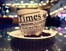 Read the newspaper on a cup of coffee