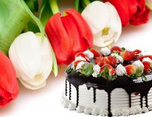 Delicious strawberry and chocolate cake - beautiful tulips