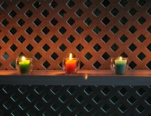 Colored candle in the garden - hot summer night
