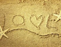 Love message on the sand - holiday at seaside