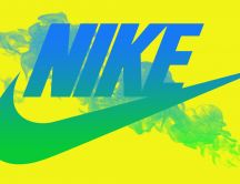 Sport time - Nike logo on a yellow wall