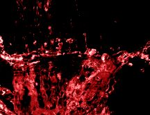 Abstract red splash on a dark background