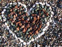 Love message on the beach - heart of stone