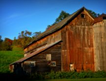 Beautiful wooden barn in the autumn sunlight