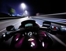 Speed race on a motorcycle in the night
