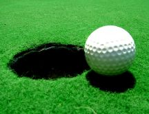 Big hole and the white golf ball on the field - HD wallpaper