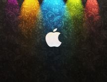 Coloured lights and the apple logo on the wall