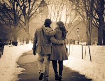 Walk in the park in winter - beautiful lovers
