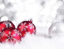 Red Christmas decorations on a silver background