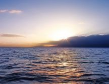 Good morning - sunrise over the calm ocean water