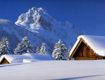 Warm wooden chalets in the mountaintop - winter season