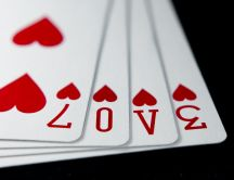 Poker cards - love message and red hearts