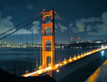 Beautiful bridge lit up on night - HD wallpaper