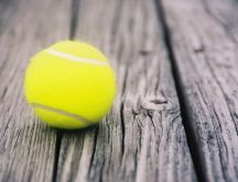 Tennis ball on the old wood