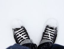 Black shoes in the white snow - Winter season