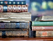 Old books in a library - HD wallpaper