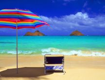 Blue water and coloured umbrella - Sun and summer