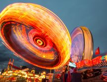 Amusement park rides with many lights