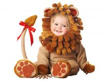 Sweet baby dressed in a bear suit with red knot on the tail