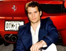 Cool Henry Cavill near the red car