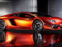 Orange Lamborghini Aventador in a garage